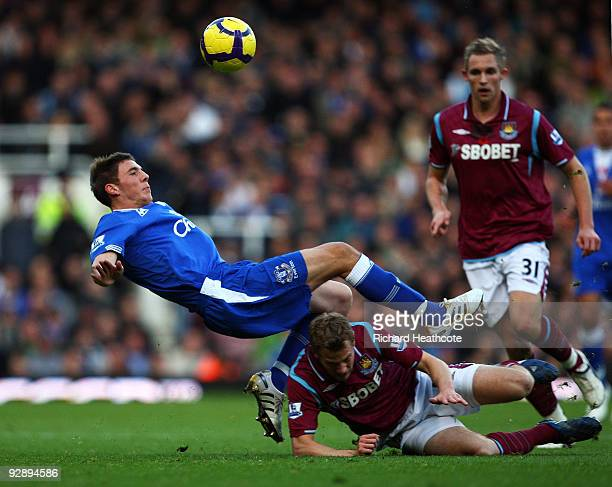 Jonathan Spector of West Ham tackles Dan Gosling of Everton during the Barclays Premier League match between West Ham United and Everton at Upton...