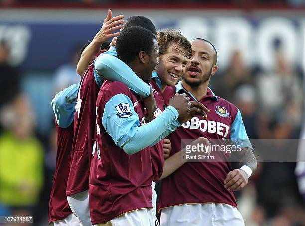 Jonathan Spector of West Ham United celebrates with team mates after scoring the opening goal during the FA Cup sponsored by EON 3rd Round match...