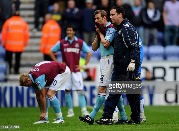 Jonathan Spector of West Ham United looks dejected following his team's relegation at the end of the Barclays Premier League match between Wigan...