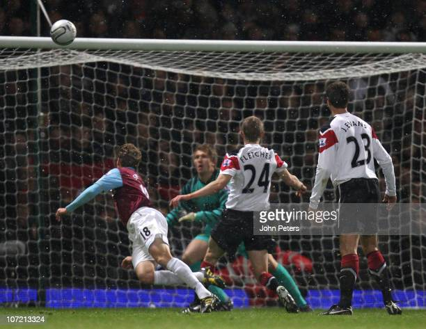 Jonathan Spector of West Ham United scores their first goal during the Carling Cup quarterfinal match between West Ham United and Manchester United...