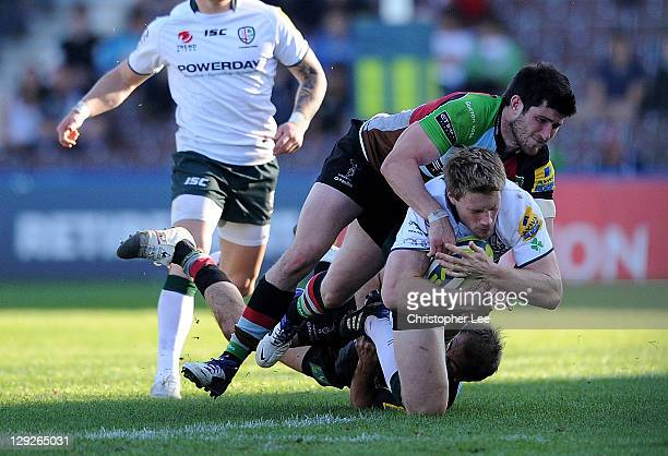 Jonathan Spratt of Irish is tackled by Ben Urdapilleta and Tom Casson of Harlequins during the LV= Cup 1st Round match between Harlequins and London...