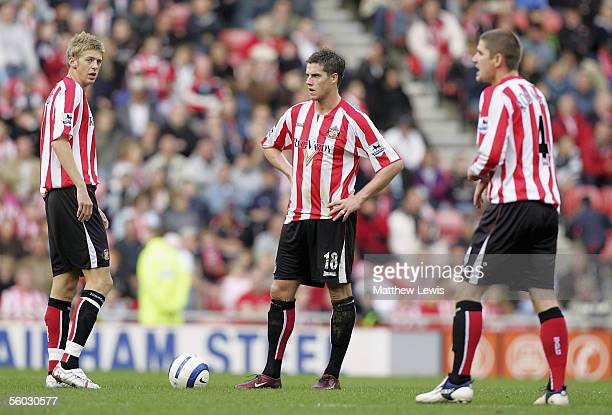 Jonathan Stead Andy Gray and Carl Robinson of Sunderland look on after Portsmouth score four goals during the Barclays Premiership match between...