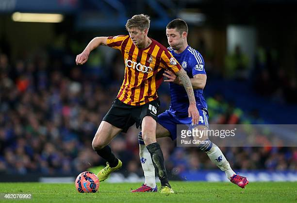 Jonathan Stead of Bradford City is challenged by Gary Cahill of Chelsea during the FA Cup Fourth Round match between Chelsea and Bradford City at...