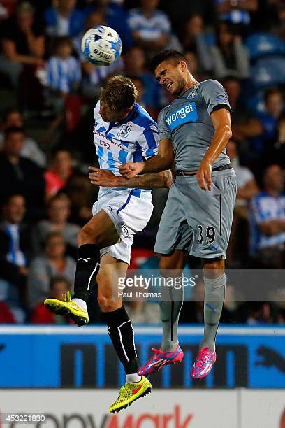 Jonathan Stead of Huddersfield in action with Mehdi Abeid of Newcastle during the Pre Season Friendly match between Huddersfield Town and Newcastle...