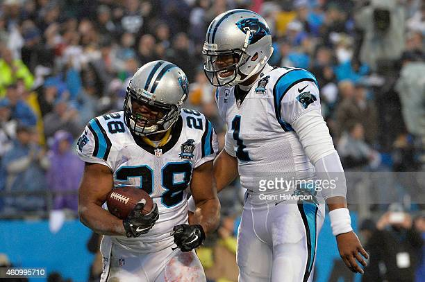 Jonathan Stewart and Cam Newton of the Carolina Panthers celebrate after a touchdown is scored by Stewart during their NFC Wild Card Playoff game...
