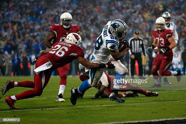 Jonathan Stewart of the Carolina Panthers breaks a tackle from Rashad Johnson of the Arizona Cardinals to score a touchdown during their NFC Wild...