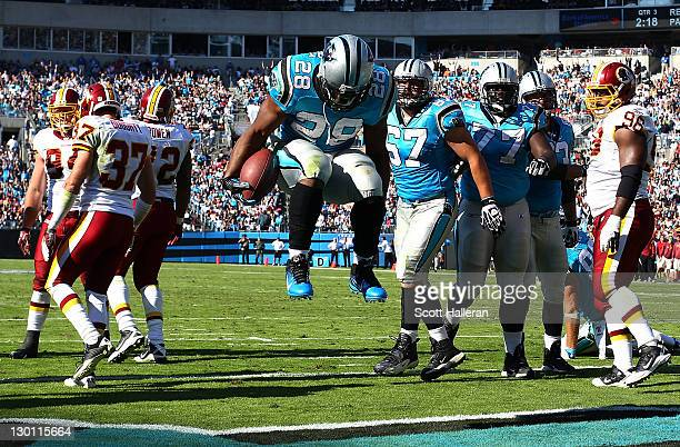 Jonathan Stewart of the Carolina Panthers celebrates a second half touchdown against the Washington Redskins during their game at Bank of America...