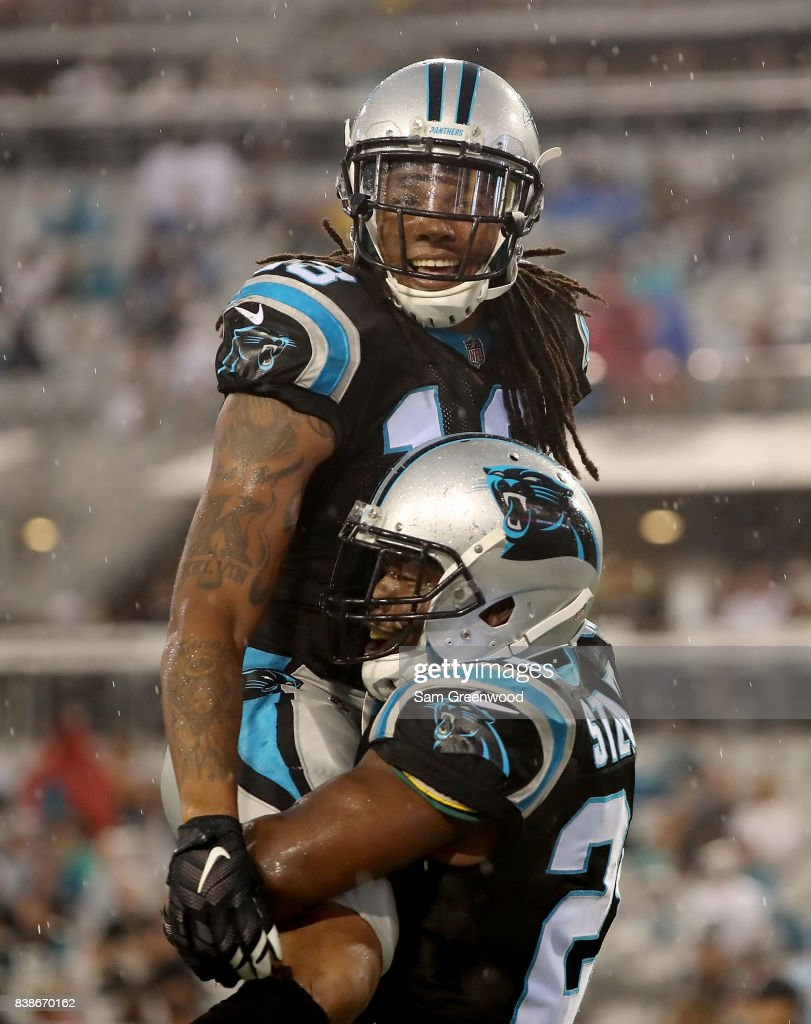Jonathan Stewart #28 of the Carolina Panthers celebrates with Kelvin Benjamin #13 following a touchdown during a preseason game against theJacksonville Jaguars at EverBank Field on August 24, 2017 in Jacksonville, Florida.