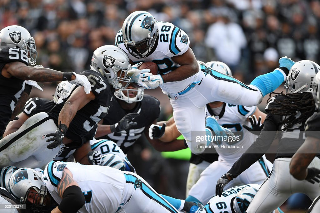 Jonathan Stewart #28 of the Carolina Panthers dives short of the endzone against the Oakland Raiders during their NFL game on November 27, 2016 in Oakland, California.