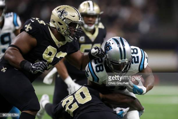 Jonathan Stewart of the Carolina Panthers is tackled by Ken Crawley of the New Orleans Saints at the MercedesBenz Superdome on January 7 2018 in New...