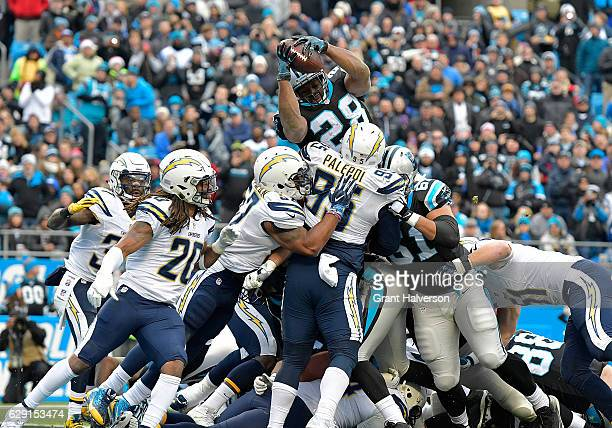 Jonathan Stewart of the Carolina Panthers leaps over the line for a touchdown against the San Diego Chargers in the 1st quarter during the game at...