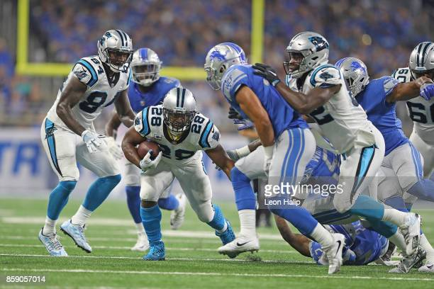 Jonathan Stewart of the Carolina Panthers runs for a first down as Tavon Wilson of the Detroit Lions makes the stop during the second quarter of the...