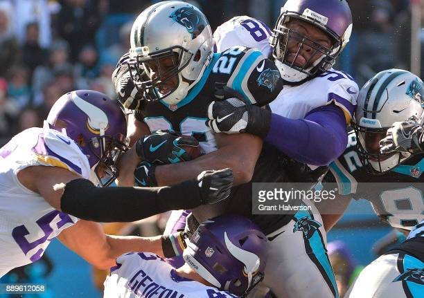 Jonathan Stewart of the Carolina Panthers runs for a touchdown agains the Minnesota Vikings in the second quarter during their game at Bank of...