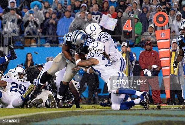 Jonathan Stewart of the Carolina Panthers runs for a touchdown against Dwight Lowery and Colt Anderson of the Indianapolis Colts in the 1st quarter...