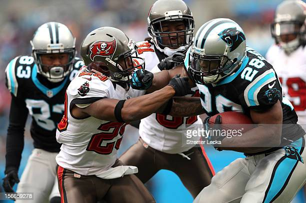 Jonathan Stewart of the Carolina Panthers runs into Leonard Johnson of the Tampa Bay Buccaneers during their game at Bank of America Stadium on...