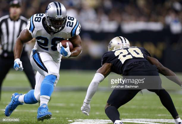 Jonathan Stewart of the Carolina Panthers runs with the ball as Ken Crawley of the New Orleans Saints defends during the first half of the NFC Wild...