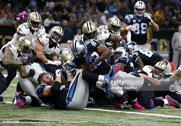 Jonathan Stewart of the Carolina Panthers scores a touchdown during the second half of a game against the New Orleans Saints at the MercedesBenz...