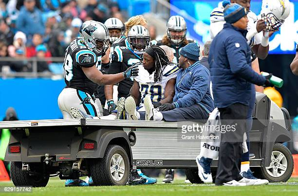 Jonathan Stewart of the Carolina Panthers talks to Melvin Gordon of the San Diego Chargers after Gordon's injury in the first half during the game at...