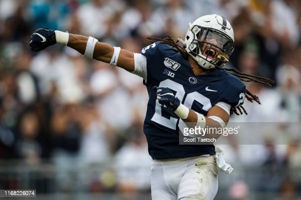 Jonathan Sutherland of the Penn State Nittany Lions celebrates after a tackle against the Pittsburgh Panthers during the second half at Beaver...