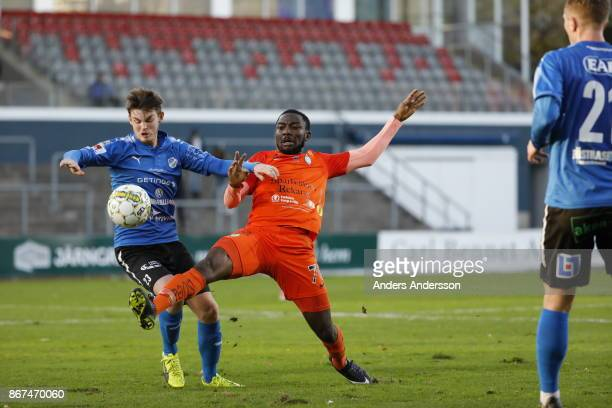 Jonathan Svedberg of Halmstad BK and Chidi Dauda Omeje of Athletic FC Eskilstuna compete for the ball during the Allsvenskan match between Halmstad...