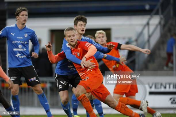 Jonathan Svedberg of Halmstad BK and Daniel Bjornkvist of Athletic FC Eskilstuna compete for the ball during the Allsvenskan match between Halmstad...