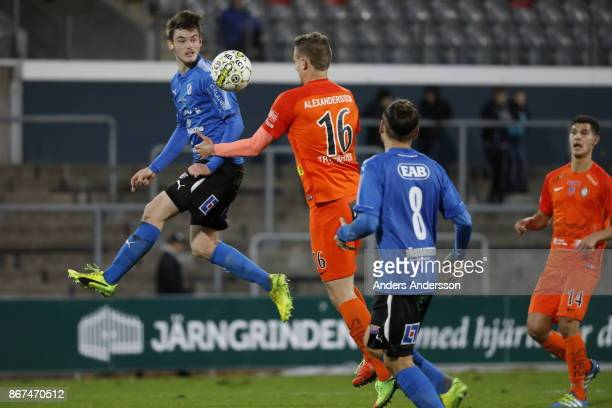 Jonathan Svedberg of Halmstad BK and Simon Alexandersson of Athletic FC Eskilstuna compete for the ball during the Allsvenskan match between Halmstad...