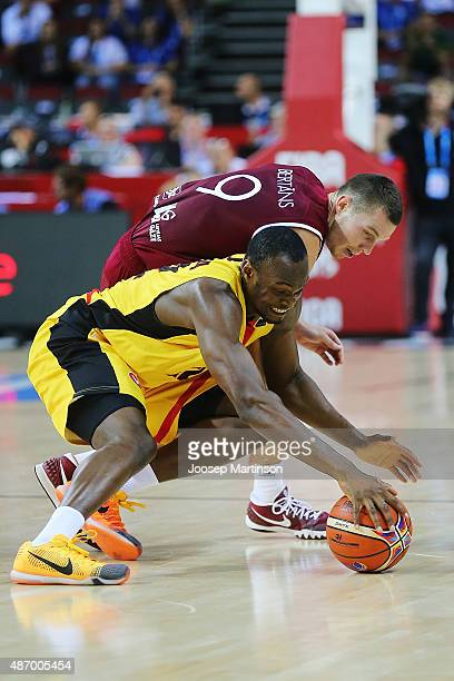 Jonathan Tabu of Belgium contests for the ball with Dairis Bertans of Latvia during the FIBA EuroBasket 2015 Group D basketball match between Belgium...