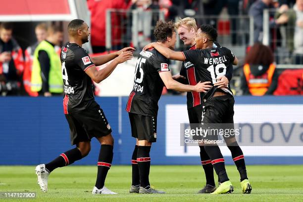 Jonathan Tah Julian Baumgartlinger Julian Brandt and Wendell all of Bayer 04 Leverkusen celebrate their sides sixth goal during the Bundesliga match...
