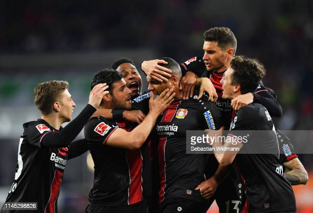 Jonathan Tah of Bayer 04 Leverkusen celebrates after scoring his team's third goal with team mates during the Bundesliga match between FC Augsburg...