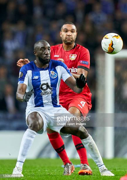 Jonathan Tah of Bayer 04 Leverkusen competes for the ball with Moussa Marega of FC Porto during the UEFA Europa League round of 32 second leg match...