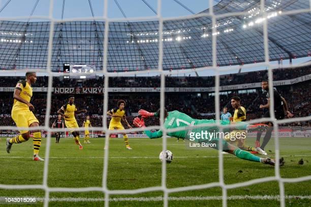 Jonathan Tah of Bayer 04 Leverkusen scores the second goal pass goalkeeper Roman Buerki of Borussia Dortmund looks on dejected during the Bundesliga...