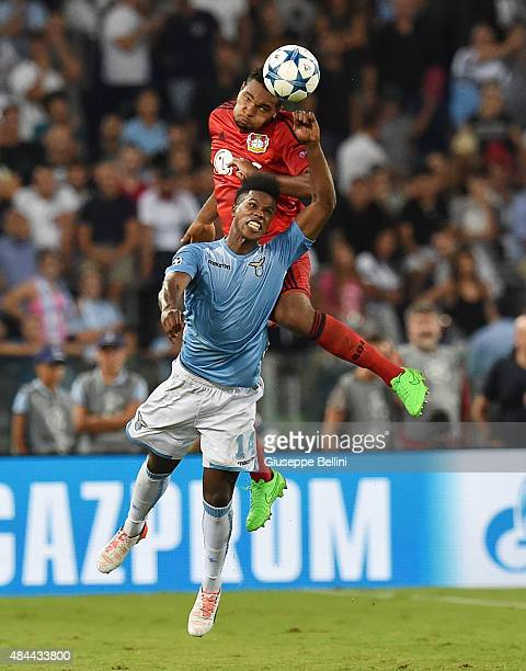 Jonathan Tah of Bayer Leverkusen and Keita of SS Lazio in action during the UEFA Champions League qualifying round play off first leg match between...