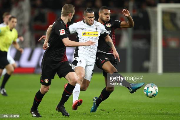 Jonathan Tah of Bayer Leverkusen fights for the ball with Raul Bobadilla of Moenchengladbach and Lars Bender of Bayer Leverkusen during the...