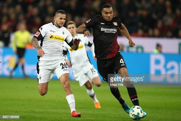 Jonathan Tah of Bayer Leverkusen is chased by Raul Bobadilla of Moenchengladbach during the Bundesliga match between Bayer 04 Leverkusen and Borussia...