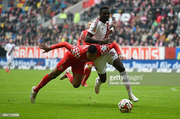 Jonathan Tah of Fortuna Duesseldorf and Peniel Mlapa of 1 FC Nuernberg battle for the ball during the Second Bundesliga match between Fortuna...