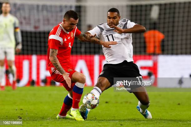 Jonathan Tah of Germany and Anton Zabolotny of Russia vie for the ball during the international friendly match between Germany and Russia on November...