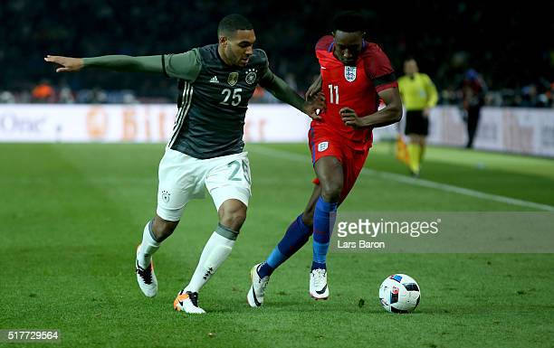 Jonathan Tah of Germany challenges Danny Welbeck of England during the International Friendly match between Germany and England at Olympiastadion on...