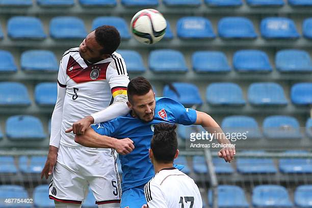 Jonathan Tah of Germany challenges Tomas Vestenicky of Slovakia during the UEFA Under19 Elite Round match between U19 Germany and U19 Slovakia at...