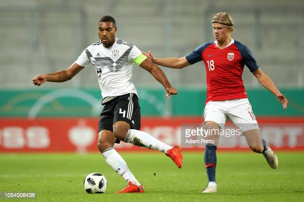 Jonathan Tah of Germany holds off Erling Braut Håland of Norway during the 2019 UEFA Under 21 European Championship Qualifier between Germany U21 and...