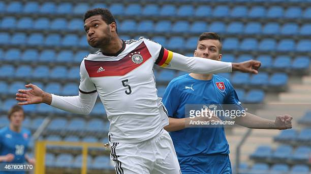 Jonathan Tah of Germany in action with Lukas Haraslin of Slovakia during the UEFA Under19 Elite Round match between U19 Germany and U19 Slovakia at...