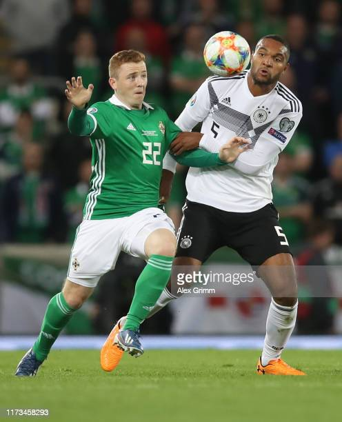 Jonathan Tah of Germany is challenged by Shayne Lavery of Northern Ireland during the UEFA Euro 2020 qualifier match between Northern Ireland and...