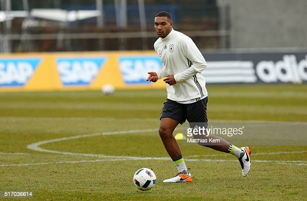Jonathan Tah of Germany runs with the ball during a Germany training session ahead of their International friendly match against England at Stadion...
