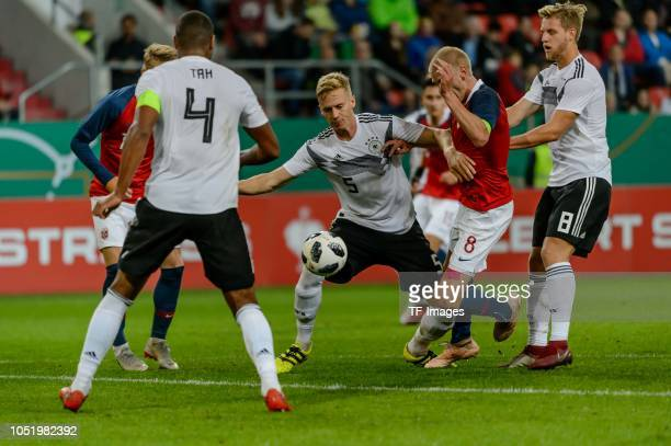 Jonathan Tah of Germany Timo Baumgartl of Germany Morten Thorsby of Norway and Arne Maier of Germany battle for the ball during the 2019 UEFA Under21...
