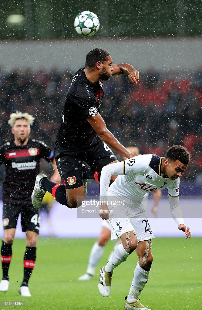 Jonathan Tah (L) of Leverkusen and Dele Alli of Tottenham battle for the ball during the UEFA Champions League group E match between Bayer 04 Leverkusen and Tottenham Hotspur FC at BayArena on October 18, 2016 in Leverkusen, North Rhine-Westphalia.
