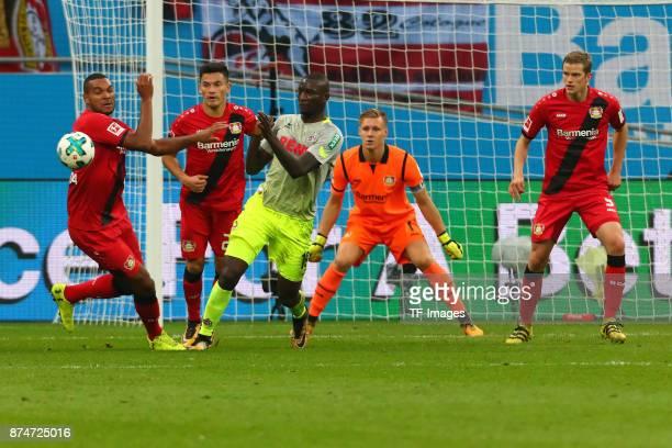 Jonathan Tah of Leverkusen Charles Aranguiz of Leverkusen and Sehrou Guirassy Koeln battle for the ball during the Bundesliga match between Bayer 04...