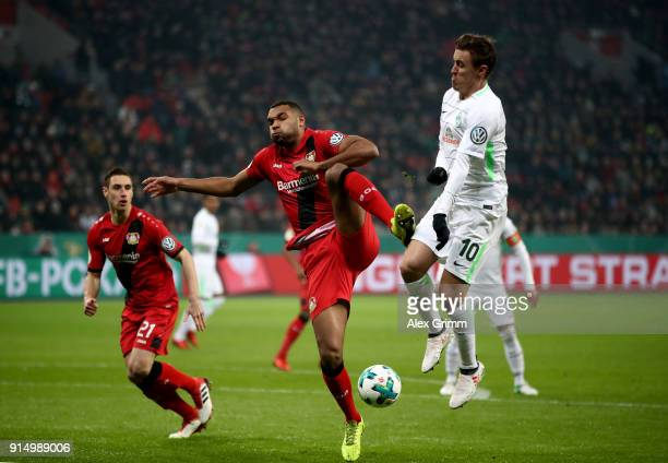 Jonathan Tah of Leverkusen tackles Max Kruse of Bremen during the DFB Cup quarter final match between Bayer Leverkusen and Werder Bremen at BayArena...