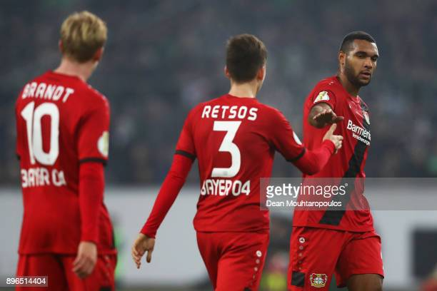 Jonathan Tah Panagiotis Retsos and Julian Brandt of Bayer 04 Leverkusen speak during the DFBPokal match between Borussia Moenchengladbach and Bayer...