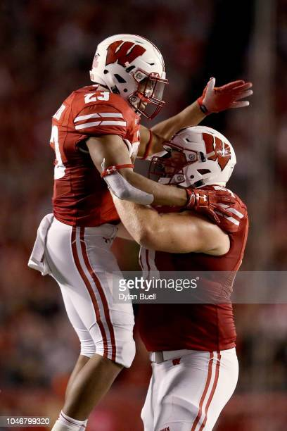Jonathan Taylor and Tyler Biadasz of the Wisconsin Badgers celebrate after scoring a touchdown in the second quarter against the Nebraska Cornhuskers...