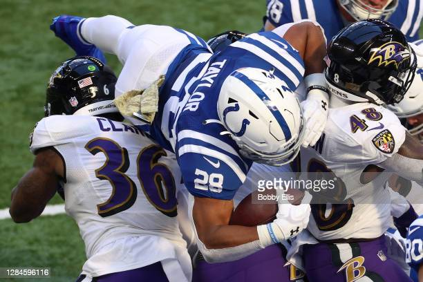 Jonathan Taylor of the Indianapolis Colts scores a touchdown against the Baltimore Ravens during the first quarter at Lucas Oil Stadium on November...