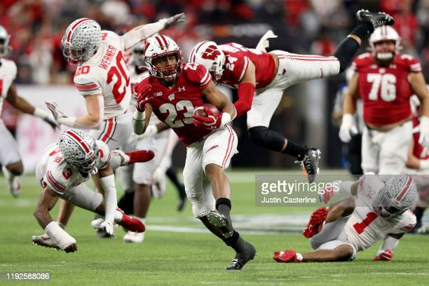 Jonathan Taylor of the Wisconsin Badgers runs for a touchdown in the Big Ten Championship game against the Ohio State Buckeyes at Lucas Oil Stadium...